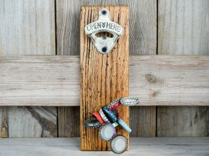 CapCollector reclaimed barn wood magnetic bottle opener will catch and hold 30-40 bottle caps.