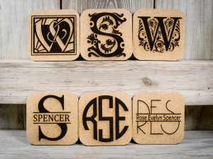 Monograms laser engraved into cork coasters