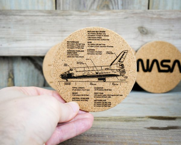 Cork coaster showing space shuttle dimensions